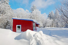 The red house on the snowfield Royalty Free Stock Photography
