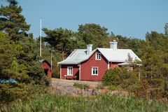 Red Swedish house in the archipelago. Red house in the Swedish archipelago in the Baltic Sea stock images