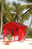 Red house on a tropical beach stock image