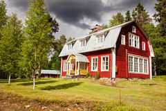 Red house under dramatic sky. Stock Photography