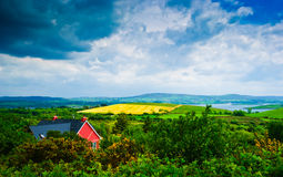 Red house under dramatic sky, Ireland Royalty Free Stock Photo