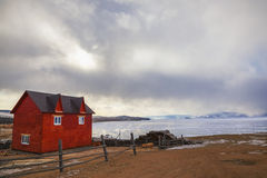 Red house in the village of Khuzhir on Lake Baikal, Russia Royalty Free Stock Photos
