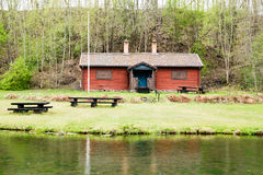 Red house by water Royalty Free Stock Photography