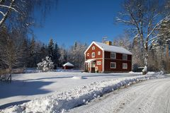 Red house in wintertime Royalty Free Stock Images