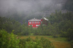 Red house in the woods in the mountains Stock Image