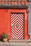 Red house wtih stripy door Stock Photography