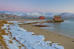 Red houses on the bay. Red houses on the frozen bay of norway Stock Photo