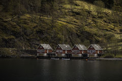 Red houses in incredible place. Royalty Free Stock Images