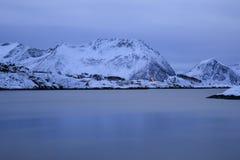 Red houses near Bergsfjorden-shoreline Stock Photos