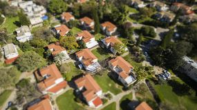 Red houses rooftops with green grass in the suburb of israel Stock Photography