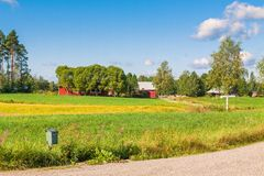 Red houses in a rural landscape Stock Photos
