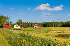 Red houses in a rural landscape Royalty Free Stock Photography
