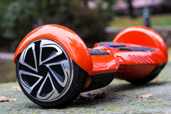 The red hoverboard side view Stock Photos