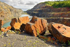 Red huge stones in an abandoned mine Stock Photo