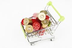 Red hunting cartridges for shotgun in metal shopping trolley. Royalty Free Stock Image