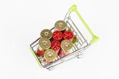 Red hunting cartridges for shotgun in metal shopping trolley. Royalty Free Stock Photography