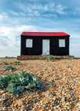 Red Hut on Rye beach Stock Photography