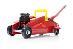 Red hydraulic floor jack isolated on white background.  stock image