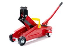 Red hydraulic floor jack isolated on white background.  stock images