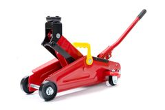 Red hydraulic floor jack on white background royalty free stock image