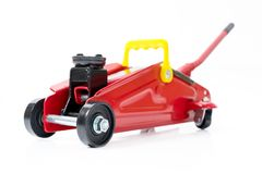 Red hydraulic floor jack on white background stock photography