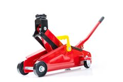 Red hydraulic floor jack on white background.  stock images