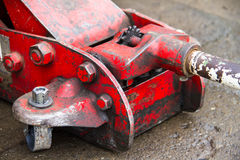 Red hydraulic jack Stock Image