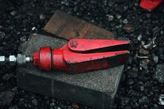 Red hydraulic repair tool claw. Red hydraulic repair claw instrument Stock Photos