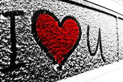Red I love you Heart symbol on frozen window of the car. Shape of heart drawn on snow on front window of the car. Heart snow. Chri. Stmas decorations and stock images