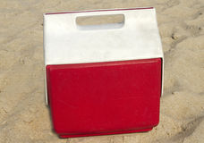 Red Ice Chest In The Sand Stock Photos