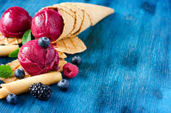 Red ice cream with berries, sorbet copy space background. Ice cream with berries, sorbet, healthy dessert summer food copy space royalty free stock photography