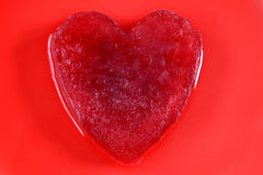 Red ice heart. A red melting ice heart Royalty Free Stock Image