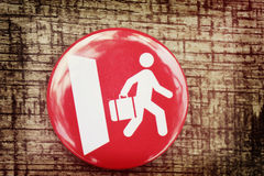 Red icon and a white man walks out the door Stock Photos