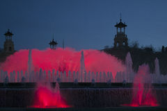Red illuminated fountain in the evening light of Barcelona Stock Photography