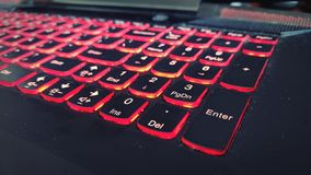 Red illuminated notebook keyboard stock images