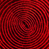 Red illuminated spiral of velcro band Royalty Free Stock Photography