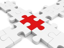 Red inddividual jigsaw puzzle in center white cross group Royalty Free Stock Photography