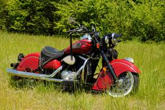 Red Indian Motorcycle. Indian Motorcycle sitting in the grass Stock Photos