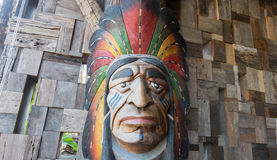 Red indian sculpt. On the wood wall Stock Photography