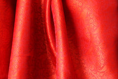 Red Indian Silk. Folds of fine red silk from India Royalty Free Stock Images