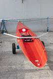 Red individual racing rowing boat. Royalty Free Stock Photo