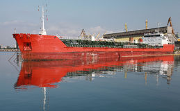 Red industrial cargo ship in port Royalty Free Stock Photo