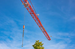 Red industrial construction crane against blue sky Royalty Free Stock Photography