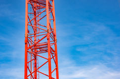 Red industrial construction crane against blue sky Royalty Free Stock Image