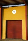 Red Industrial Door. Red garage door on an industrial building royalty free stock image