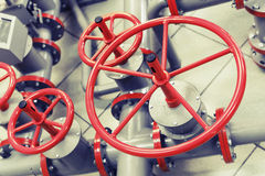 Red industrial valves on modern pipeline Royalty Free Stock Photo