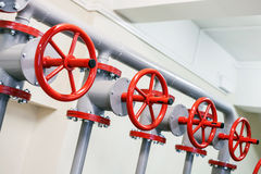 Red industrial valves in a row Royalty Free Stock Image