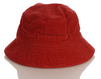 Red infant or baby hat. Red baby or infant hat with reflection on white background Stock Photography