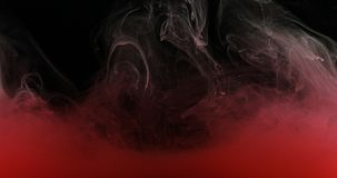 Red Ink Paint in Water Creating Liquid Artistic Shapes Royalty Free Stock Image