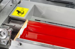 Red ink roller, printing press industrial machine. Hand caution sign for awareness royalty free stock photos